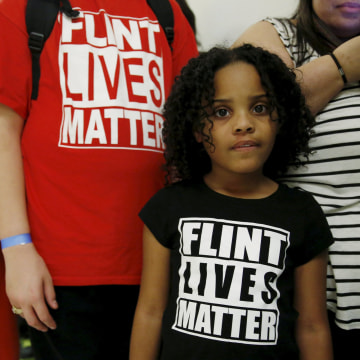 "Image: Flint Michigan residents wait in line for a House Oversight and government Reform hearing on ""Examining Federal Administration of the Safe Drinking Water Act in Flint"