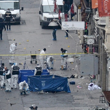 Image: Police forensic experts inspect the area after a suicide bombing in central Istanbul
