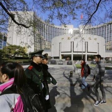 People walk past PBOC headquarters in Beijing