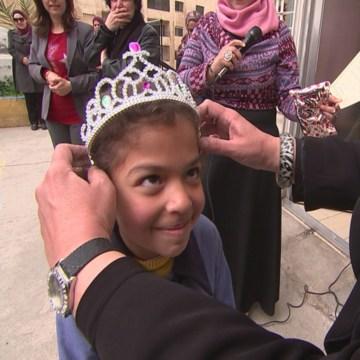 Image: Hanaa Al Fasih, age 7, being crowned by principal Maha Al Ashqar
