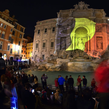 Image: A Belgian flag is display on the Trevi Fountain in Rome