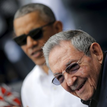 Image: U.S. President Barack Obama and Cuban President Raul Castro arrive to attend a baseball game at Estadio Latinoamericano in Havana