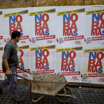"Image: Banners reading in Spanish ""No more"" protest against the visit of United States President Barack Obama."