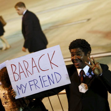 Image: A supporter of U.S. President Obama gestures for the cameras.