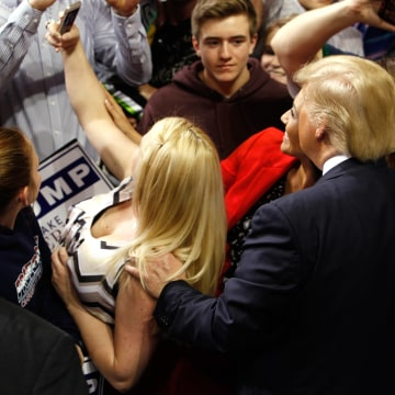 Image: U.S. Republican presidential candidate Donald Trump poses for a photograph with supporters at the end of a campaign rally in Fayetteville, North Carolina