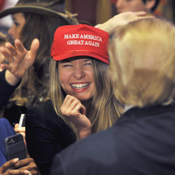 Image: A woman smiles after getting an autograph by U.S. Republican presidential candidate and businessman Donald Trump on her hat after he spoke at a campaign rally South Point Resort and Casino in Las Vegas