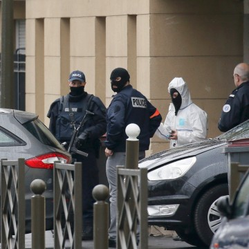 Image: Entrance of an apartment building after a raid in Argenteuil, France