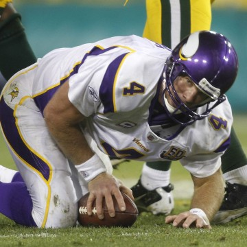 Image: Minnesota Vikings quarterback Brett Favre is sacked by the Packers defense in Green Bay