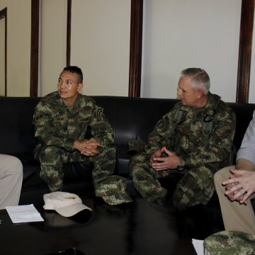 Colombian Defense Minister Luis Carlos Villegas talks with Army Corporal Jair de Jesus Villar, after he was freed by the National Liberation Army, or ELN, in Barrancabermeja