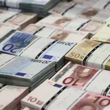 Wads of euro banknotes are stacked at the GSA company's headquarters in Vienna