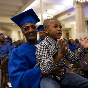 Image: Anthony Lewis, 52, of the Bronx, with his son Elias, 6, during the graduation from the year-long Ready, Willing & Able transitional work program on March 31 at the Church of St. Ignatius Loyola on the Upper East Side of Manhattan.