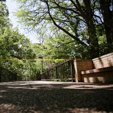 Image: Police tape blocks off an area in Waller Creek on the University of Texas campus in Austin