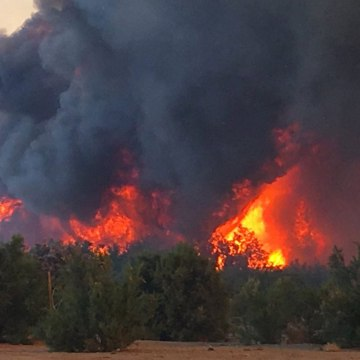 Image: A flareup of a wildfire near Needles