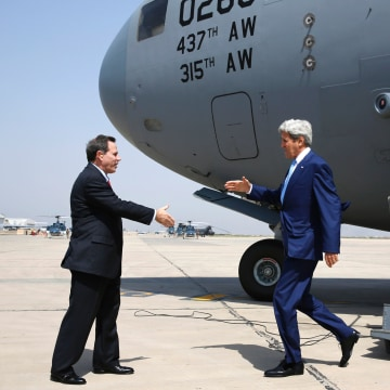 Image: Ambassador Stuart Jones greeted Kerry in Baghdad.