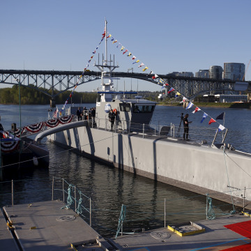 "Image: The autonomous ship ""Sea Hunter"", developed by DARPA, is shown docked in Portland, Oregon before its christening ceremony"