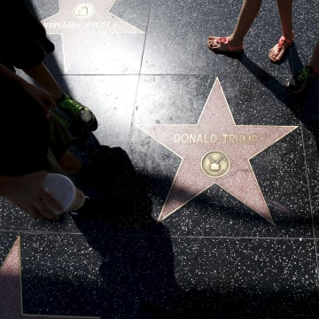 Image: People gather around the star of U.S. Republican presidential candidate Donald Trump on the Hollywood Walk of Fame in Hollywood