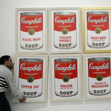 Image: File photo of a worker hanging a print by US artist Andy Warhol at Es Baluard museum in Palma de Mallorca