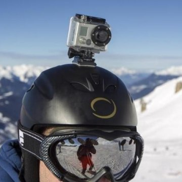 A skier wears a GoPro camera on his helmet as he rides down the slopes in the ski resort of Meribel