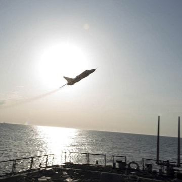 Image: An U.S. Navy picture shows what appears to be a Russian Sukhoi SU-24 attack aircraft flying over the U.S. guided missile destroyer USS Donald Cook in the Baltic Sea