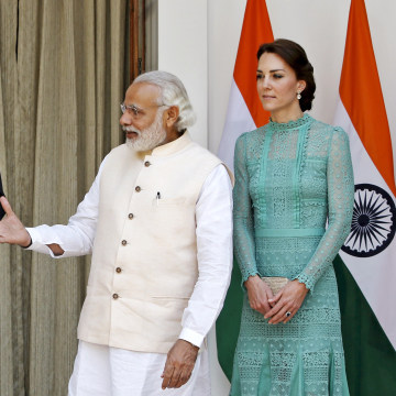 Image: Britain's Prince William shakes hands with India's PM Modi as Catherine, Duchess of Cambridge, smiles during a photo opportunity at Hyderabad House in New Delhi