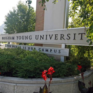 A sign stands at the main entrance to the campus of Brigham
