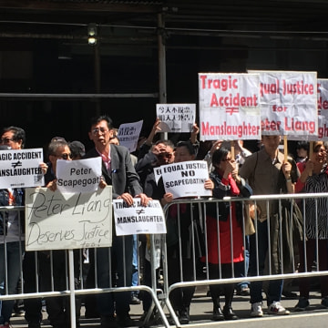 Image: Protesters support Officer Peter Liang outside a Brooklyn courthouse before his sentencing for manslaughter in the killing of Akai Gurley, in New York