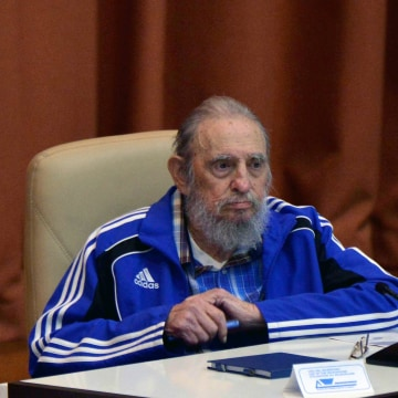 Cuban Former President Fidel Castro applauding during the closing ceremony of VII Congress of Cuban Communist Party