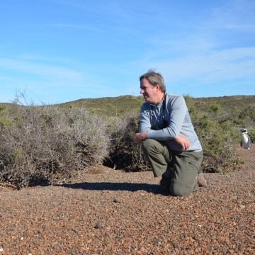 Cristián Samper, CEO of Wildlife Conservation Society, photographed with Magellanic penguin.