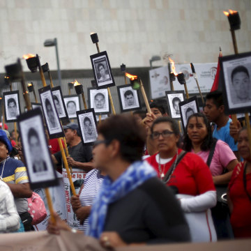Protesters criticize government's handling of the investigation in the case of 43 students, in Mexico City.