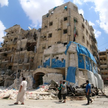 Image: People inspect the damage at Al Quds hospital in Aleppo