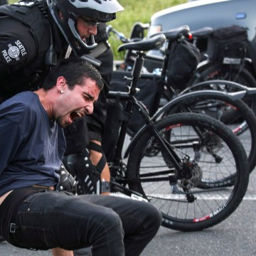 Image: Police detain a protester during anti-capitalist protests following May Day marches in Seattle