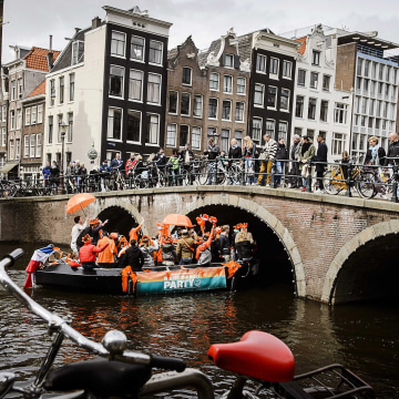 Image: Tourists in Amsterdam on April 30