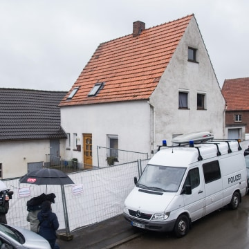Image: A police vehicle parked in front of the house of a couple suspected of murder in Hoexter, Germany,