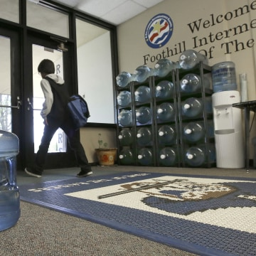Image: Water bottles line the entrance to Foothill Intermediate School in Loma Rica, Calif.