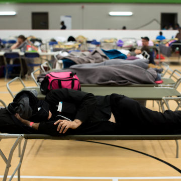 Image: Fort McMurray residents sleep at a community centre in Anzac