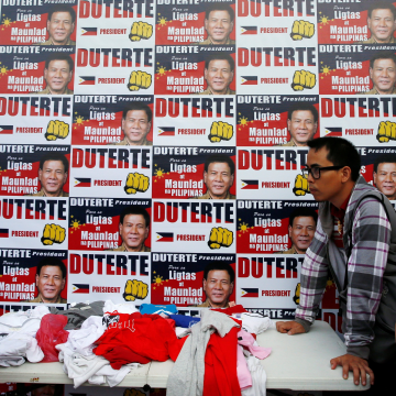 "Image: Supporters of Rodrigo ""Digong"" Duterte line up for campaign T-shirts"