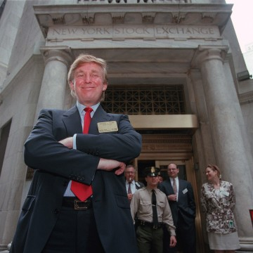 Image: Trump poses for photos outside the New York Stock Exchange after the listing of his stock