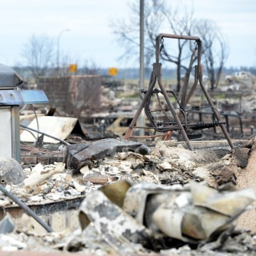 Image: Burned barbecue and swing in Fort McMurray