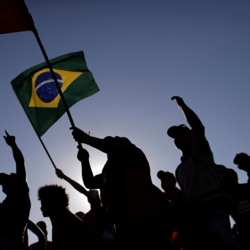 Members of the Landless Workers Movement (MST) take part in a protest against the impeachment of Brazil's President Dilma Rousseff in Brasilia