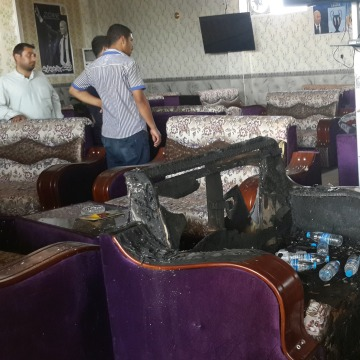 Image: People gather at a cafe after an attack in the predominately Shi'ite Muslim town of Balad