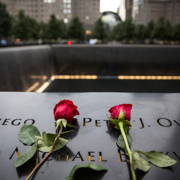 Image: Flowers are laid at the 9-11 Memorial site