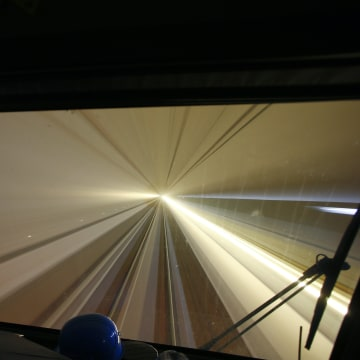 Image: The view from a train driver's cabin of the high-speed Gotthard Base Tunnel.