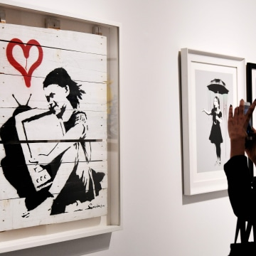 "Image: Banksy's ""Girl With TV"""