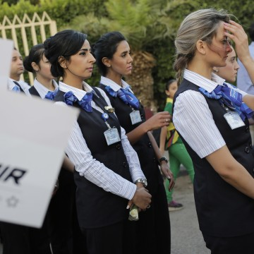 Image: EgyptAir workers line up during a candlelight vigil