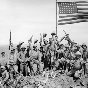 "Photo taken by Army Pfc. George Burns at the summit of Mount Suribachi is nearly identical to the so-called ""gung-ho"" photo shot by the AP's Joe Rosenthal."