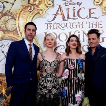 "Image: Cast members Cohen, Wasikowska, Hathaway and Depp pose at the premiere of ""Alice Through the Looking Glass"" at El Capitan theatre in Hollywood"
