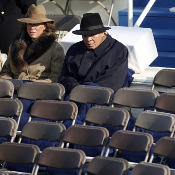 Image: Muhammad Ali sits with his wife Yolanda as they await the inauguration ceremony of Barack Obama as the 44th President