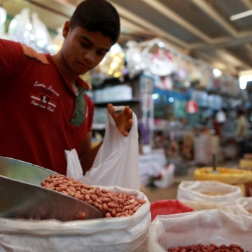 Image: A boy sells legumes at a market on the first day of Ramadan in Benghazi