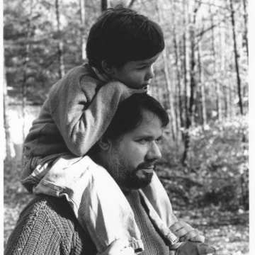 Poet Martin Espada and his son Klemente, taken by Espada's father, renowned civil rights and community activist as well as acclaimed photographer, Frank Espada.