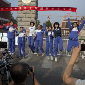 Image: Students jump after completing exam in Beijing